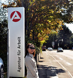 Young woman standing in front of the signboard of the employment agency in Boeblingen, Germany. Photograph: Azchael alias Max-Leonhard von Schaper /flickr